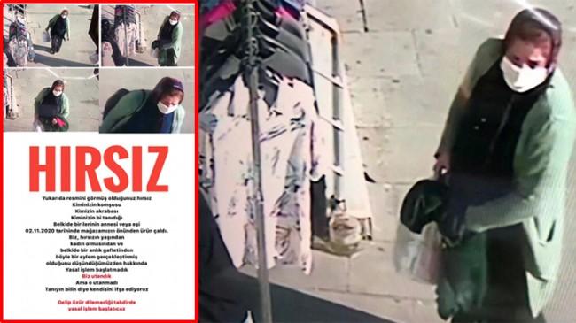Mağazanın tezgahından kıyafet çalan hırsızın fotoğrafını afiş yapıp cama astı